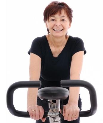Spinning senior woman